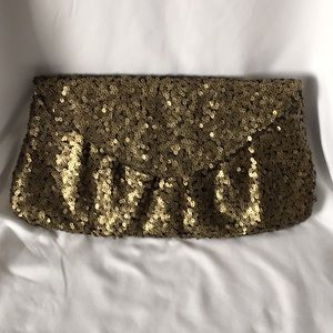 Black and gold sequin clutch